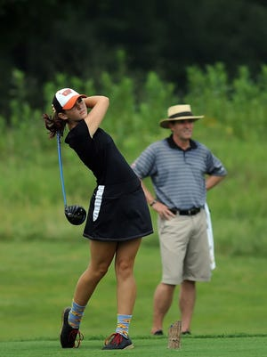 Samantha Hatter drives from the second tee at the Women's City Golf Championship  at Coyote Crossing.