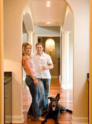 """Graceful arches and hardwood floors were part of the appeal when D.J. Trigg and Sharron Hubbard walked through one of the homes in Village of WestClay in Carmel, Ind., during filming for HGTV's  """"House Hunters."""" Did they get divorced afterward? Probably."""