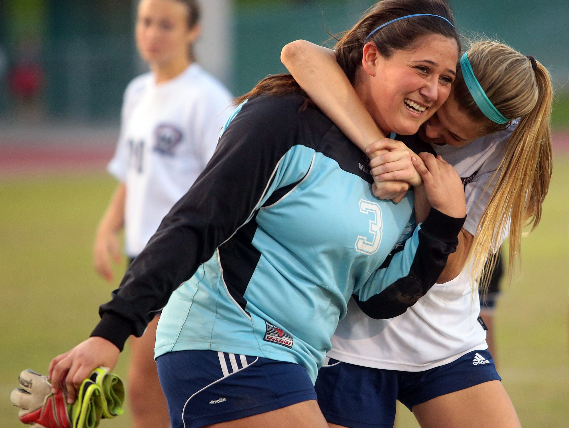 La Quinta goalkeeper Arianna Rodriguez (3) gets hugged after blocking all but one penalty kick during the Blackhawks' 1-1 playoff victory over visiting Ocean View on Thursday, February 26, 2015 at La Quinta. After a two scoreless overtime periods, the game came down to penalty kicks with the Blackhawks winning those, 4-1.