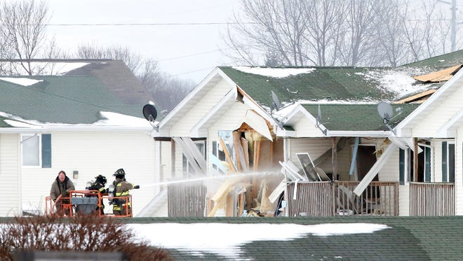 Members of the Beaver Dam Fire Department fight a fire in an apartment complex Wednesday, March 7, 2018, after a controlled detonation of explosive materials was conducted. The explosives were found after a previous explosion killed the apartment's tenant Monday.