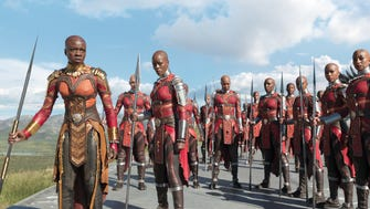 "Okoye (Danai Gurira) and Ayo (Florence Kasumba) with the Dora Milaje in a scene from ""Black Panther."""