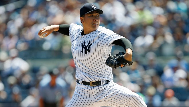 Yankees starting pitcher Masahiro Tanaka delivers during the first inning of a baseball game against the Cleveland Indians in New York, Sunday, Aug. 7, 2016.