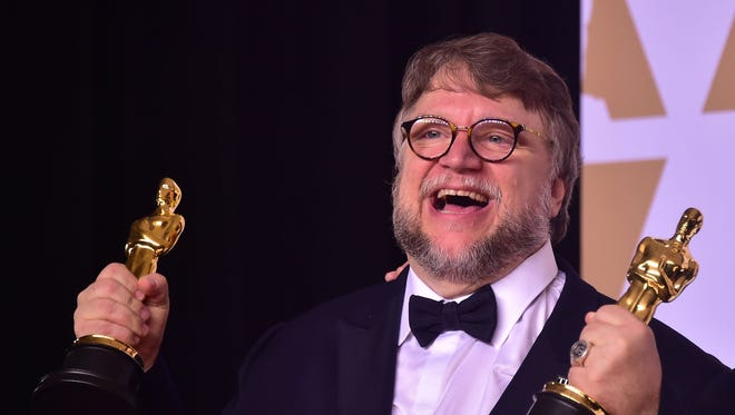 Director Guillermo del Toro with the Oscars for best picture and best director at Academy Awards on March 4, 2018, in Hollywood.