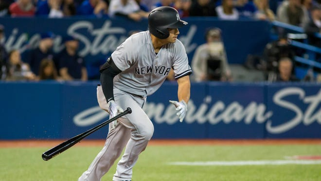 New York Yankees shortstop Tyler Wade (12) hits a double to score two runs against the Toronto Blue Jays in the sixth inning at Rogers Centre.