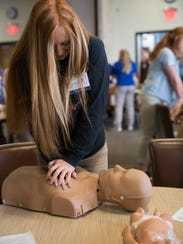 Sharidyn Newell practices lifesaving chest compressions