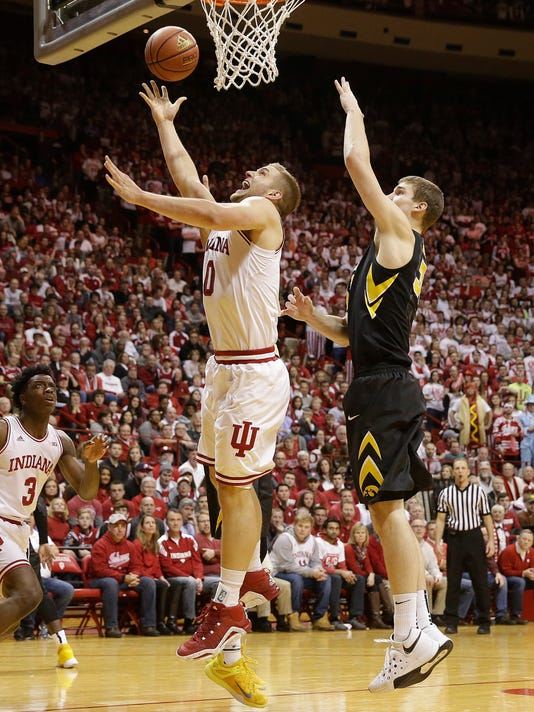 Indiana's Max Bielfeldt (0) puts up a shot against Iowa's Adam Woodbury during the second half of an NCAA college basketball game Thursday, Feb. 11, 2016, in Bloomington, Ind. Indiana won 85-78. (AP Photo/Darron Cummings)