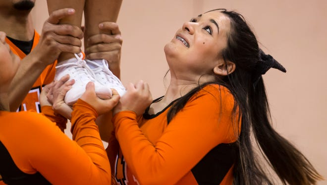 NTID student Felicia Boria of Perris, California, hoists a flyer during a recent cheerleading practice at RIT.