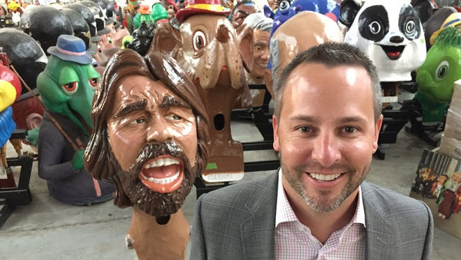 Jim Dailey, 39, of Grosse Pointe Park is a cofounder of the Big Head Corps, which works with the Parade Co. to raise money for America's Thanksgiving Parade. Dailey will be wearing the Bob Seger Big Head in the 2015 parade. Here he is at the warehouse on Mt. Elliott in Detroit, where they keep all the props.