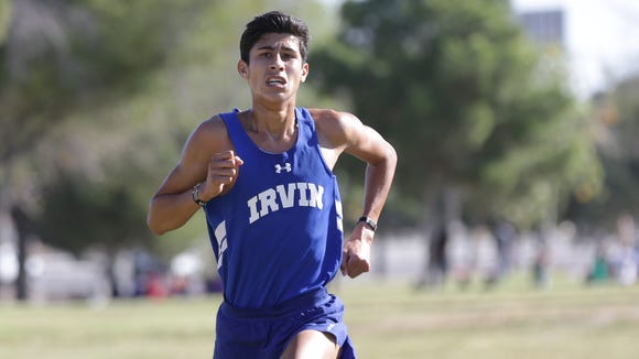 Irvin senior Aaron Gillam nears the finish line all alone Thursday morning in the District 1-5A Cross Country Championships at the Chamizal National Memorial. Gillam won in a time of 16:07.70 ahead of Burges's Sam Zambrano, 16:32.67.
