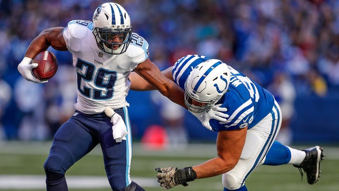 Indianapolis Colts nose tackle Al Woods (99) chases down Tennessee Titans running back DeMarco Murray (29) in the first half of their game at Lucas Oil Stadium Sunday, Nov. 26, 2017.