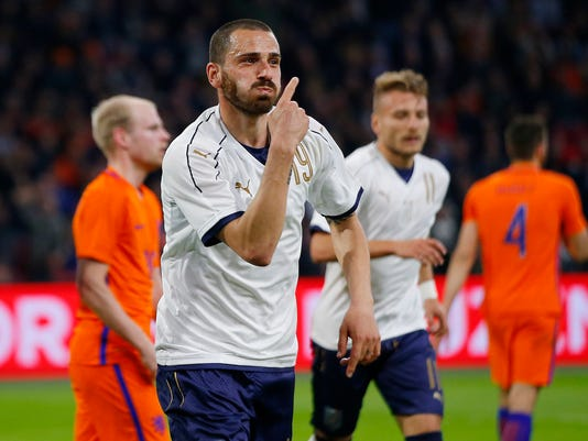 FILE - In this Tuesday, March 28, 2017 file photo, Italy's Leonardo Bonucci celebrates after scoring his side's second goal during the international friendly soccer match between The Netherlands and Italy at the Amsterdam ArenA stadium, Netherlands. Italy defender Leonardo Bonucci is close to completing a transfer from Juventus to rival AC Milan that could signal a shift in the balance of power in Serie A. (AP Photo/Peter Dejong, File)