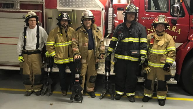 Members of several different Henderson County volunteer fire departments show off the emergency extrication tools that they have been able to purchase with funds from a recent funding initiative by the county.