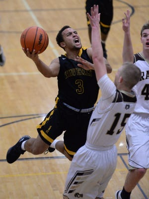 Waverly's Jaden Sutton goes up to the basket during the game against Holt on Tuesday, Dec. 6, 2016 at Holt High School.