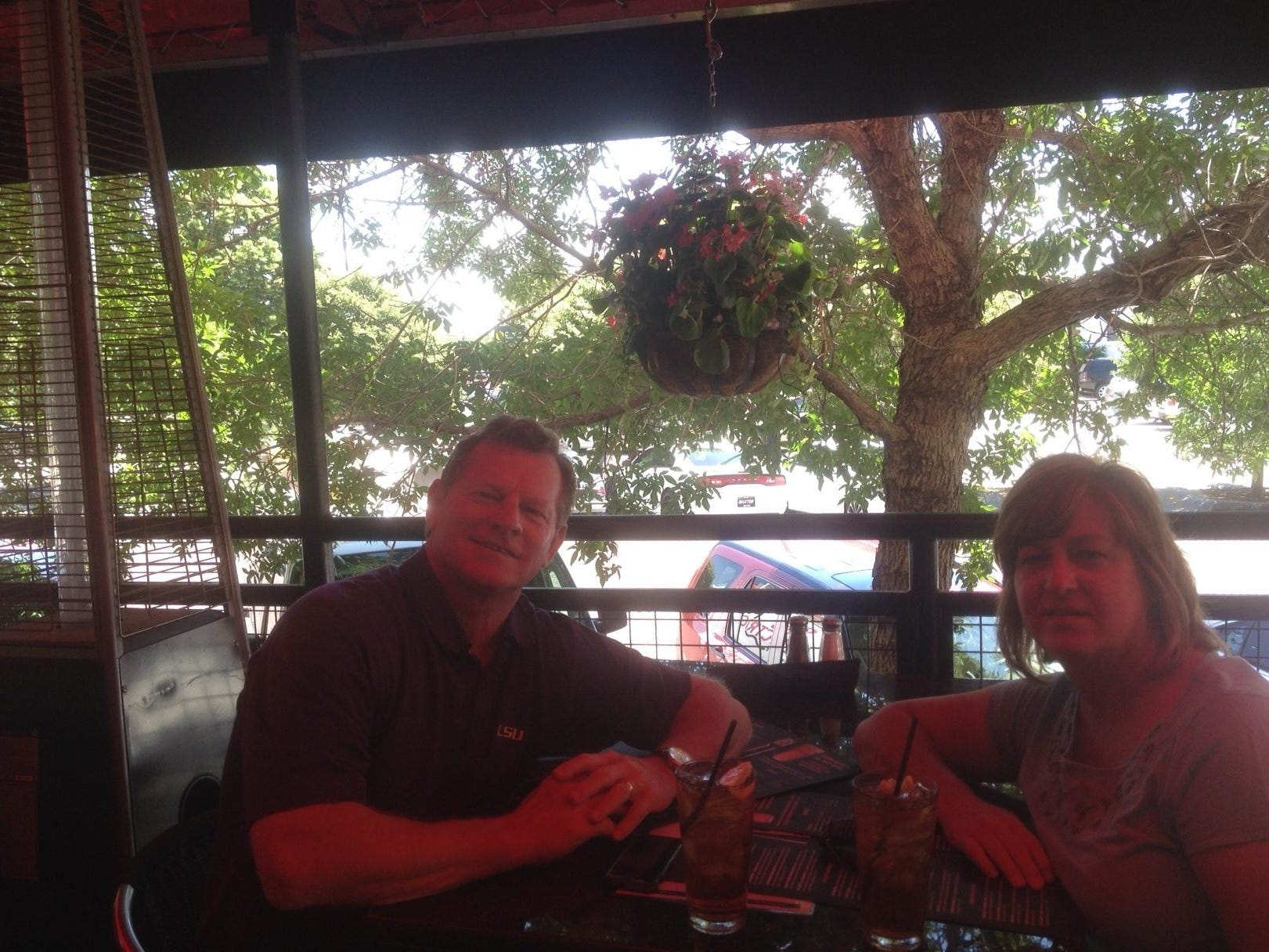 John LeDoux and wife Tommie LeDoux of Sulphur eat lunch at Rock Bottom restaurant and brewery Wednesday. They are staying in Omaha as long as the Tigers do.