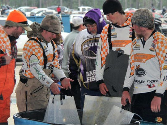 Scott Ellis, second from left, and his Tennessee bass fishing teammates, check out their catches in the Texas Lunker Challenge.