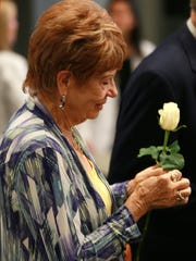Betty Lewis held a rose presented to her during Monday's Donor Memorial Service at the Texas Tech University Health Sciences Center El Paso Paul L. Foster School of Medicine. The service honors those who have donated their bodies to medical education. Deby Lewis, Betty Lewis' daughter, donated her body to be used in research by students at the school.
