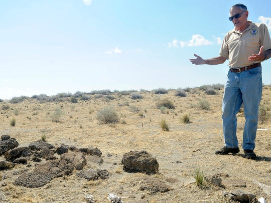 Jon Nowlin discusses a pile of tufa laid in an east