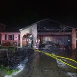 Crews from Loveland and Fort Collins worked to stop a garage fire from spreading to a home Saturday night in north Loveland.