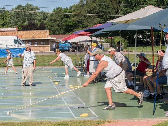 Shuffleboard players during the Michigan Shuffleboard Tournament at Bailey Park on Tuesday.
