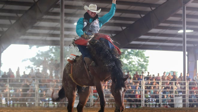 Jonny Walker competes in bareback riding during the Bill Hoy Kiwanis Rodeo held on Friday at the Montgomery County 4-H Arena.