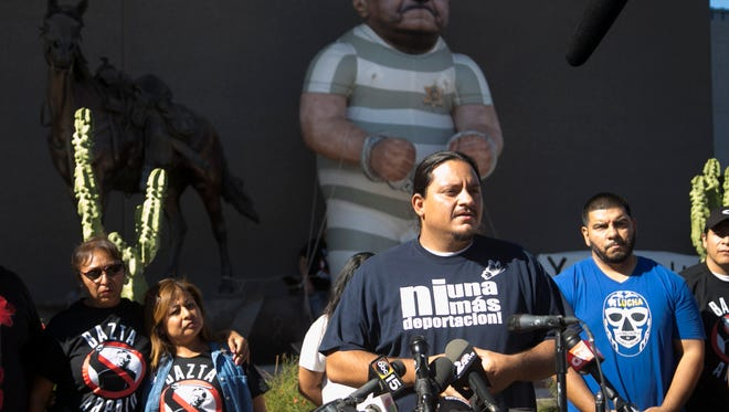 Carlos Garcia, director of Puente, speaks in front of the Maricopa County Sheriff's Office headquarters in Phoenix on Wednesday, Nov. 9, 2016. Arpaio lost the Maricopa County Sheriff's race too Paul Penzone. Puente often protests Arpaio's policies.