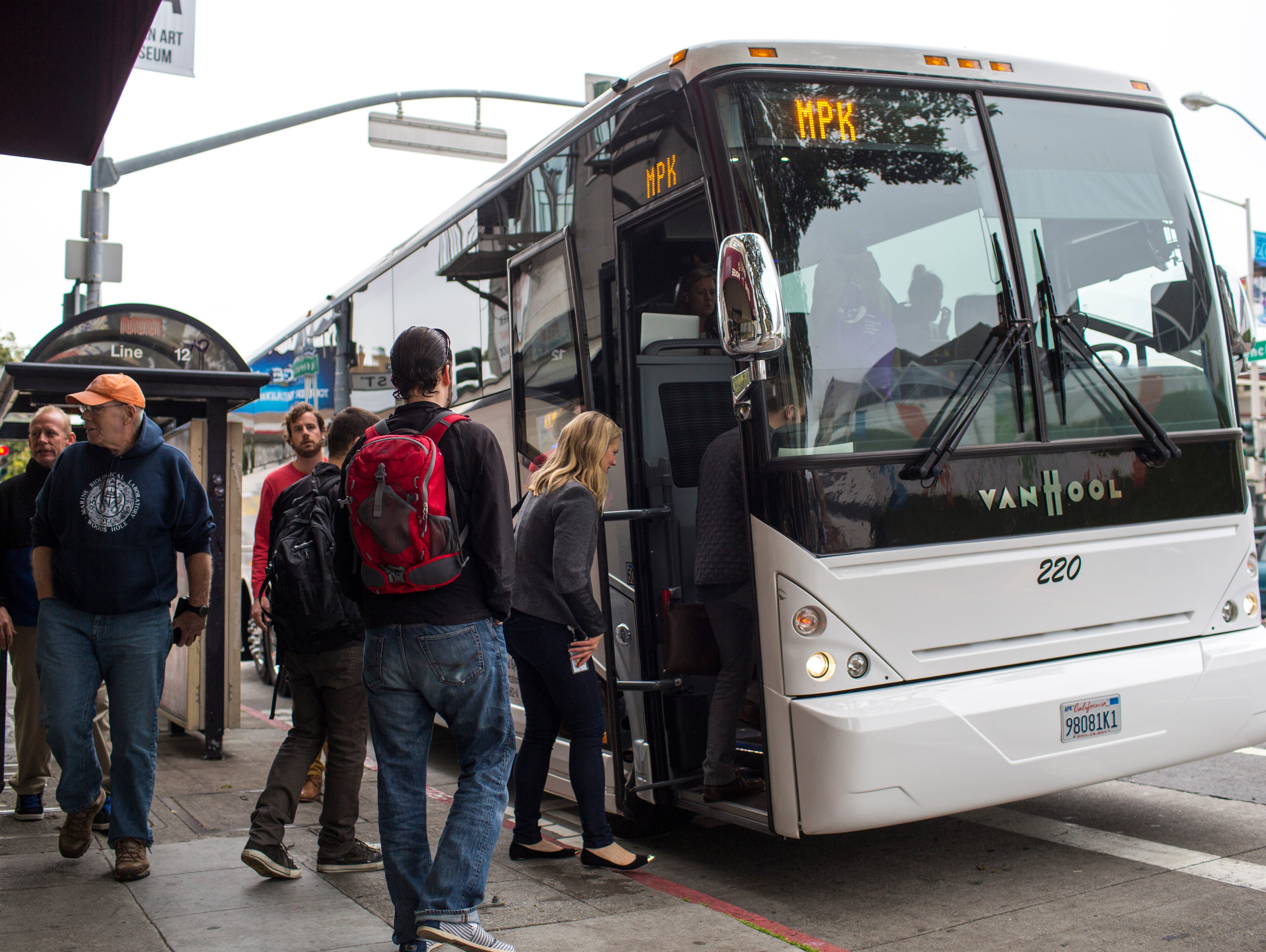 Software engineers, designers and IT employees of technology companies board shuttle buses to Silicon Valley on April 14, 2014, in the Mission District of San Francisco. Approximately 35,000 employees use shuttle buses each day to be dropped off at G