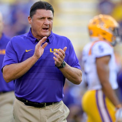 LSU head coach Ed Orgeron claps for his players during