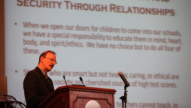 Keynote speaker Dr. Maurice Elias of Rutgers University addresses members of the education community at a 2013 conference on school security.