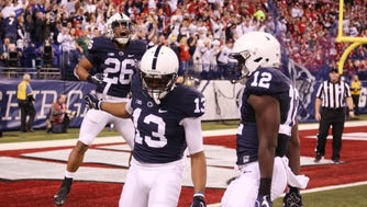 Penn State Nittany Lions wide receiver Saeed Blacknall (13) celebrates after scoring a touchdown against the Wisconsin Badgers.