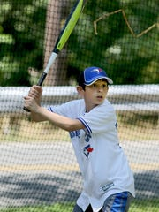 Mike Shipula, 9, gets ready to swing at a pitch during batting practice at his home in Readington. Mike works on his baseball skills daily with help from his dad, Mike Shipula. He has won the Readington-Tewksbury Junior Baseball League's home run derby for three consecutive years.