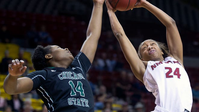 New Mexico State forward Brianna Freeman rips the rebound away from Chicago State's Sh'Toya Sanders Saturday afternoon at the Pan American Center.