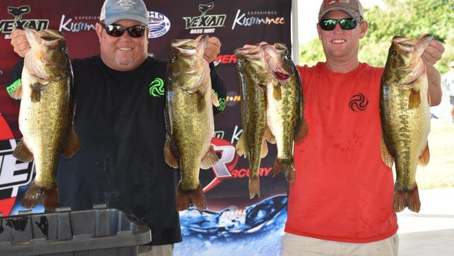 Melbourne's Jim Folks, left, and Jeremy Smith of Plant City took this first-day catch in the Nov. 6-7 Xtreme Bass Series Championship on Lake Okeechobee. It included three bass over 8 pounds. They went on to win the $40,000 first prize with a two-day total of 53.24 pounds. They added a 9.18-pounder to their second-day catch.