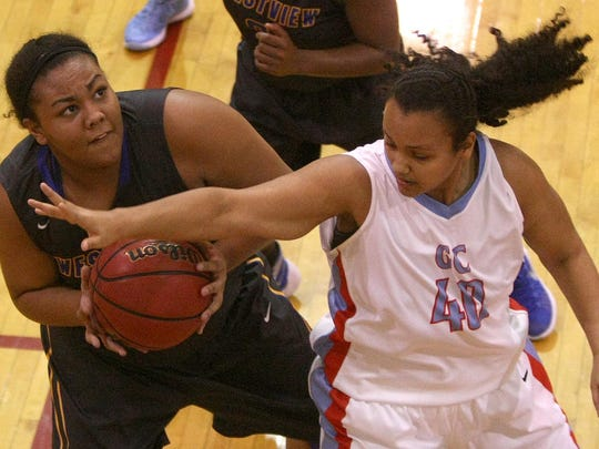 Westview's Reagan Johnson (50) looks to shoot over Gibson County's Serena Roach (40) Saturday in Dyer.