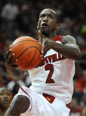 Russ Smith drives for a basket during the Red-White Scrimmage game at the KFC Yum! Center on Saturday. Oct. 12, 2013