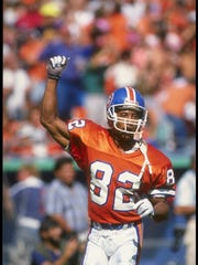 23 Sep 1990:  Wide receiver Vance Johnson of the Denver Broncos celebrates during a game against the Seattle Seahawks at Mile High Stadium in Denver, Colorado.  The Broncos won the game, 34-31. Mandatory Credit: Mike Powell  /Allsport