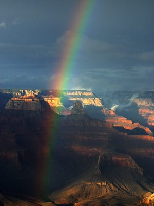 A rainbow arches through the Grand Canyon National Park in northern Arizona.