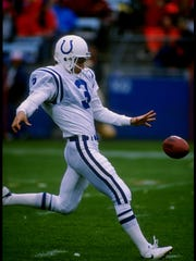 Colts Punter Rohn Stark kicks during a game against the Denver Broncos at Mile High Stadium in Denver, Colorado on Oct. 15, 1989.