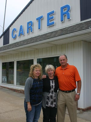 From left: Carole Hebl, Mary Ann Carter and Gary Junge. Junge Auto Group has taken over the franchise of Carter Ford, a fixture in Oxford for more than four decades.