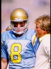 Rick Neuheisel talks with UCLA QB Troy Aikman during