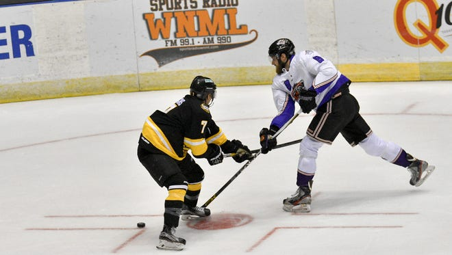 Knoxville Ice Bears forward Joseph Manno, right, shoots against the Mississippi RiverKings on Friday at Civic Coliseum.