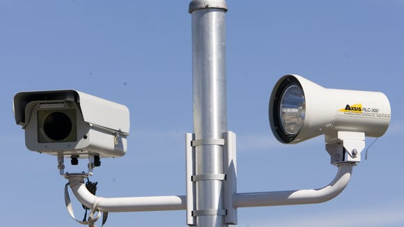 The Arizona House has passed a bill that would bar cities from using red light cameras and photo enforcement.