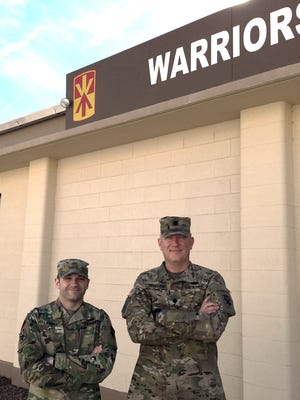 Maj. Pete Lawall, left, and Lt. Col. Bruce Bredlow are helping to prepare the 2nd Battalion, 43rd Air Defense Artillery Regiment for an upcoming deployment.