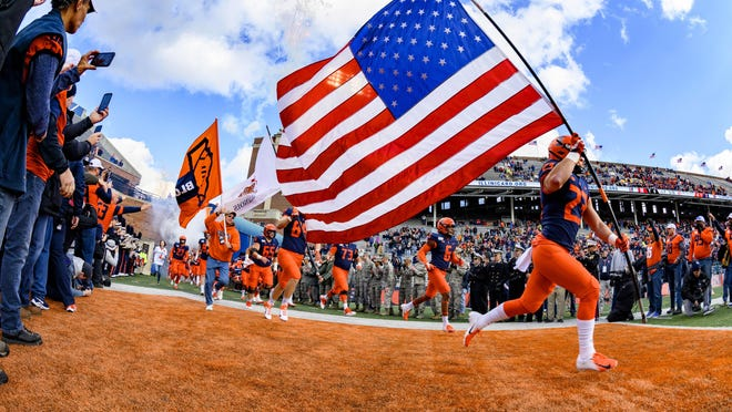 Nov 2, 2019; Champaign, IL, USA; The Illinois Fighting Illini run onto the field prior to the first half against the Rutgers Scarlet Knights at Memorial Stadium.