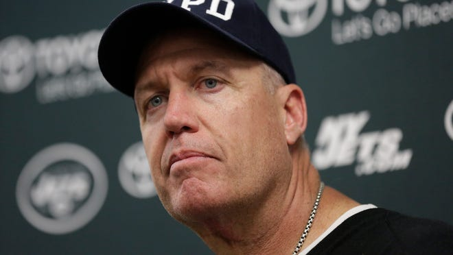 Jets head coach Rex Ryan listens during a news conference following Sunday's 37-24 win against the Miami Dolphins in Miami Gardens, Fla. The Jets fired coach Rex Ryan and general manager John Idzik on Monday after one of the most disappointing seasons in franchise history.