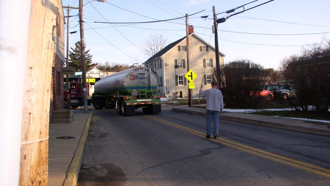 Fuel tanker nearly strikes bridge