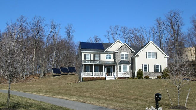 Solar panels can be mounted to the roof of a structure and/or designed to work with a pole- or ground-mounted option, like the 8.9-kilowatt system that was installed by Hudson Solar of Rhinebeck for this residence in Hopewell Junction.