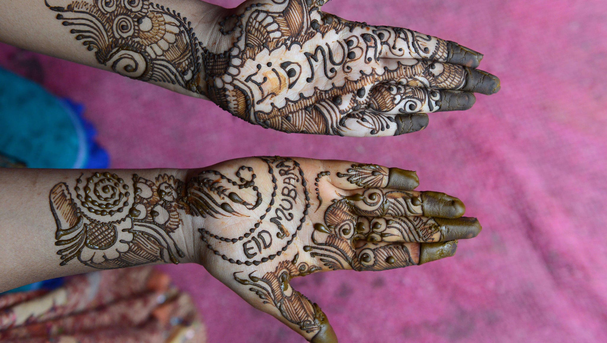 A woman displays henna decorations on her hands in Hyderabad, India.
