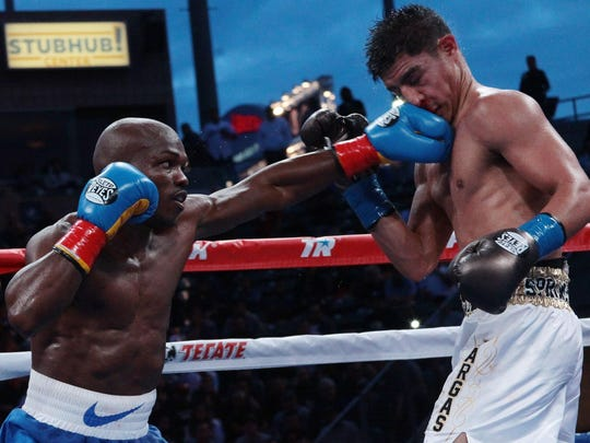 Timothy Bradley of Cathedral City (left) connects to the face of Jessie Vargas during Saturday night's 12-round WBO welterweight fight in Carson. Bradley won his first fight since Oct. 12, 2013.
