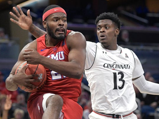 SMU guard Ben Emelogu II (21) grabs a rebound in front of Cincinnati forward Tre Scott (13) during the second half of an NCAA college basketball quarterfinal game at the American Athletic Conference tournament Friday, March 9, 2018, in Orlando, Fla. Cincinnati won 61-51. (AP Photo/Phelan M. Ebenhack)
