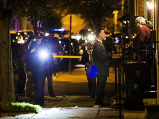 Police investigate the scene of a shooting in the 1100 block of Elm Street in Wilmington on March 30. Candidates for mayor are scheduled to debate public safety issues Thursday.